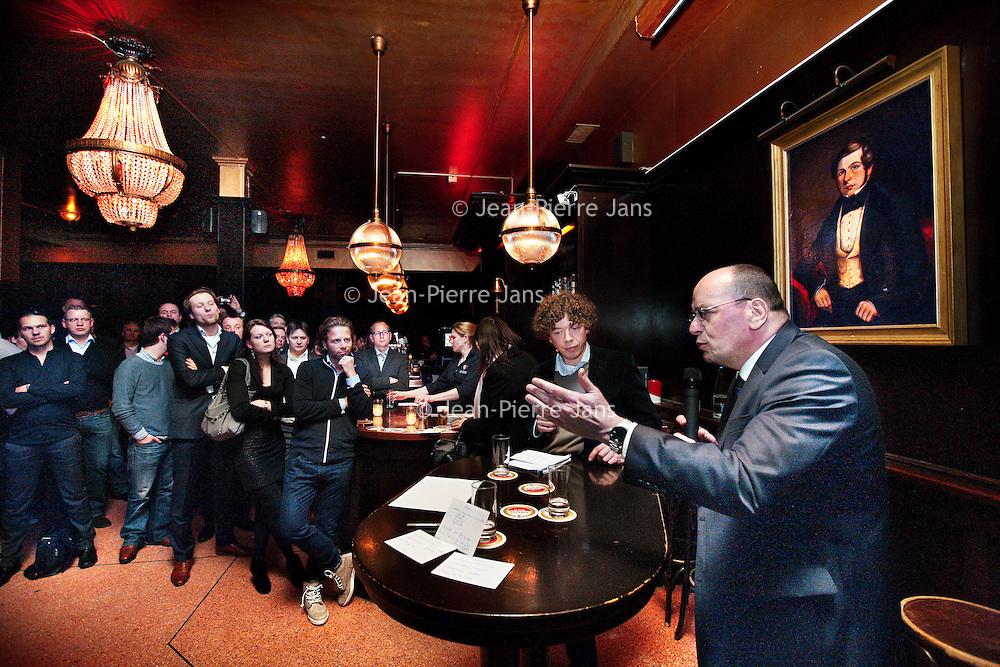 Nederland, Amsterdam , 5 maart 2012..Fred Teeven staatssecretaris van Veiligheid en Justitie in debat met VVD-ers in het café de Heeren van Amstel op het Thorbeckeplein.Foto:Jean-Pierre Jans