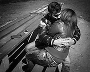 migrant couple hugging at the park