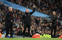 West Ham United manager David Moyes (left), assistant manager Stuart Pearce and Manchester City manager Pep Guardiola (right)