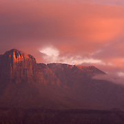 El Capitan is bathed in the pink light of dawn in Guadalupe Mountains National Park, TX.