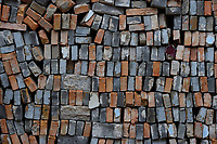 Used bricks stapled up for re-use. Beiyue Hengshan Mountain, Datong, Hunyuan County, Shanxi Province, China