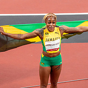 TOKYO, JAPAN - JULY 31:   Elaine Thompson-Herah of Jamaica celebrates after winning the gold medal in the 100m Final for women during the Athletics competition at the Olympic Stadium at the Tokyo 2020 Summer Olympic Games on July 31, 2021 in Tokyo, Japan. (Photo by Tim Clayton/Corbis via Getty Images)