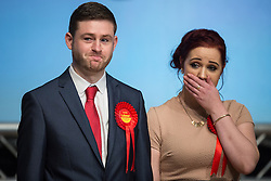 © Licensed to London News Pictures . 04/12/2015 . Oldham , UK . Labour candidate JIM MCMAHON and his partner CHARLENE DUERDEN as McMahon is declared the winner at the Oldham West and Royton by-election , at the Queen Elizabeth Hall in Oldham . The by-election was called following the death of MP Michael Meacher . Photo credit : Joel Goodman/LNP