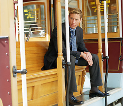 Buinessman sitting on a trolley car