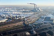 Nederland, Noord-Holland, Amsterdam, 11-12-2013; Westelijk Havengebied, Westhaven. Bergen steenkool en erts bij Overslag Bedrijf Amsterdam (OBA). Centrale Hemweg (kolengestookt) in de achtergrond.<br /> Western Harbour Amsterdam, Westhaven. Mountains of coal and ore Overslagbedrijf Amsterdam (OBA), Transshipment Compagny. Electricityplant, coal fired, in the background.<br /> luchtfoto (toeslag op standaard tarieven);<br /> aerial photo (additional fee required);<br /> copyright foto/photo Siebe Swart.