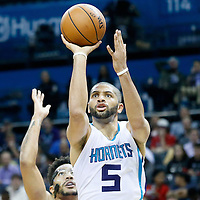 03 November 2015: Charlotte Hornets forward Nicolas Batum (5) takes a jump shot past Chicago Bulls guard Derrick Rose (1) during the Charlotte Hornets  130-105 victory over the Chicago Bulls, at the Time Warner Cable Arena, in Charlotte, North Carolina, USA.