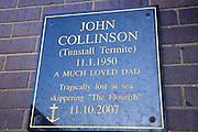 Memorial plaque to fisherman lost at sea, Bridlington, Yorkshire, England