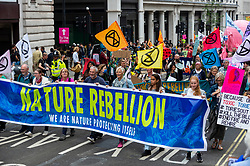 """© Licensed to London News Pictures. 04/09/2021. LONDON, UK.  Climate activists from Extinction Rebellion take part in a March for Nature from Trafalgar Square to Marble Arch to highlight the effect of climate change on the loss of plant and animal life.  The event takes place on day thirteen of the two week 'Impossible Rebellion' protest to """"target the root cause of the climate and ecological crisis"""".  Photo credit: Stephen Chung/LNP"""