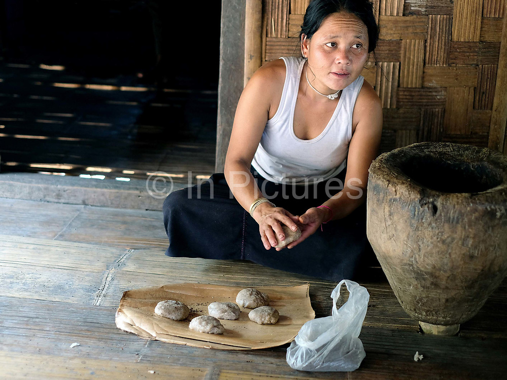 Making traditional 'Khao Papa' sticky rice cakes for the 'man festival' in the White Lahu / Mussur Khao ethnic minority village of Ban Huay San, Bokeo province, Lao PDR. One of the most ethnically diverse countries in Southeast Asia, Laos has 49 officially recognised ethnic groups although there are many more self-identified and sub groups. These groups are distinguished by their own customs, beliefs and rituals.