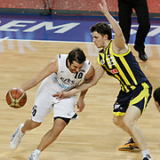 Efes Pilsen's Kerem TUNCERI (L) and Fenerbahce Ulker's Marko TOMAS (R) during their Turkish Basketball league derby match Efes Pilsen between Fenerbahce Ulker at the Sinan Erdem Arena in Istanbul Turkey on Sunday 24 April 2011. Photo by TURKPIX