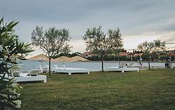 THEMENBILD - weiße Rattanliegen auf einer grünen Wiee am leeren Strand, aufgenommen am 03. Juli 2020 in Novigrad, Kroatien // white rattan loungers on a green meadow on the empty beach, in Novigrad, Croatia on 2020/07/03. EXPA Pictures © 2020, PhotoCredit: EXPA/ Stefanie Oberhauser