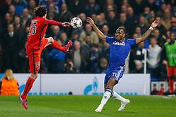 Adrien Rabiot of Paris Saint-Germain and Didier Drogba of Chelsea compete for the ball - Photo mandatory by-line: Rogan Thomson/JMP - 07966 386802 - 11/03/2015 - SPORT - FOOTBALL - London, England - Stamford Bridge - Chelsea v Paris Saint-Germain - UEFA Champions League Round of 16 Second Leg.