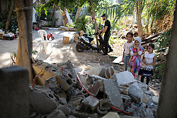 © Licensed to London News Pictures. 16/08/2020. Beirut, Lebanon. Young children pose for a photo in the Karantina district of Beirut, which has been badly destroyed following the huge explosion in Beirut Port on 4 August. Photo credit : Tom Nicholson/LNP
