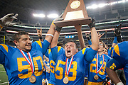 Chapel Hill Offensive Linemen Marco Orpineda and Pedro Valdez show te 3A Championship Trphy to the audience after defeating Alvarado at Cowboys Stadium on Friday.