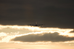 An Airbus A380 heads towards the late afternoon sun after taking off at London's Heathrow Airport (LHR / EGLL).