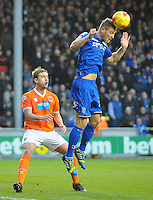 Birmingham City's Michael Morrison heads clear under pressure from Blackpool's Steven Davies<br /> <br /> Photographer Kevin Barnes/CameraSport<br /> <br /> Football - The Football League Sky Bet Championship - Blackpool v Birmingham City - Saturday 6th December 2014 - Bloomfield Road - Blackpool<br /> <br /> © CameraSport - 43 Linden Ave. Countesthorpe. Leicester. England. LE8 5PG - Tel: +44 (0) 116 277 4147 - admin@camerasport.com - www.camerasport.com