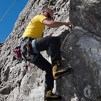Rock Climbing on Rundle Rock near town of Banff in Alberta's Banff National Park, Canada.
