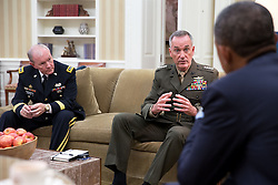 President Barack Obama meets with Gen. Joseph F. Dunford, Jr. and Gen. Martin Dempsey, Chairman of the Joint Chiefs of Staff, left, in the Oval Office, Sept. 30, 2014. (Official White House Photo by Pete Souza)<br /> <br /> This official White House photograph is being made available only for publication by news organizations and/or for personal use printing by the subject(s) of the photograph. The photograph may not be manipulated in any way and may not be used in commercial or political materials, advertisements, emails, products, promotions that in any way suggests approval or endorsement of the President, the First Family, or the White House.