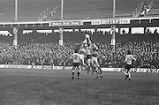 A group of players jump high to challege for the ball during the All Ireland Senior Gaelic Football Semi Final, Dublin v Kerry in Croke Park on the 23rd of January 1977. Dublin 3-12 Kerry 1-13.
