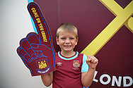 a Young West Ham United fan looks on outside London Stadium before k/o. Premier league match, West Ham Utd v AFC Bournemouth at the London Stadium, Queen Elizabeth Olympic Park in London on Sunday 21st August 2016.<br /> pic by John Patrick Fletcher, Andrew Orchard sports photography.