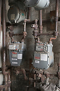 dusty gas meters in the cellar of a housing complex