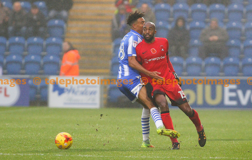 Nigel Atangana of Leyton Orient (red) passes the ball under pressure during the Sky Bet League 2 match between Colchester United and Leyton Orient at the Weston Homes Community Stadium in Colchester. November 12, 2016.<br /> Arron Gent / Telephoto Images<br /> +44 7967 642437