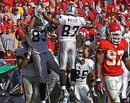 Oakland Raiders wide receiver Courtney Anderson (83) celebrates his second quarter touchdown with teammate Alvis Whitted (87) against Kansas City at Arrowhead Stadium in Kansas City, Missouri, November 19, 2006.  The Chiefs beat the Raiders 17-13.<br />