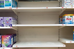 © Licensed to London News Pictures. 31/07/2021. London, UK. Nearly-empty shelves of detergent in Sainsbury's, north London. Record breaking numbers of people have been forced to self-isolate after being alerted by the NHS Covid-19 app. The pingdemic has seen staff shortages at supermarkets, resulting in less stock making its way to supermarket shelves. Labour leader Sir Keir Starmer has demanded that the government brings forward the end to self-isolation from 16 August to 7 August.  Photo credit: Dinendra Haria/LNP