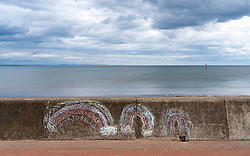 View of  chalk drawings with rainbows on Portobello  promenade during coronavirus lockdown April 2020. Scotland, UK