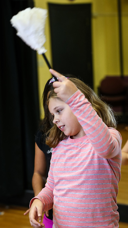 """(10/31/15, FRAMINGHAM, MA) Meaghan May, 10, of Cadette Girl Scout Troop 85195, rehearse """"It's a Hard Knock Life"""" from Annie the Musical at the Performing Arts Center of MetroWest (PAC) in Framingham on Saturday. The troop was working on their Music and Entertainment Technology badge. Daily News and Wicked Local Photo/Dan Holmes"""
