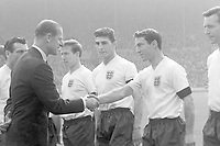 Football - 1961 Home Championship - England 9 Scotland 3 (15/4/1961)<br /> <br /> England's Jimmy Greaves is introduced to Prince Philip, with Michael 'Mick' McNeil (centre) and Bobby Charlton (left) at Wembley.