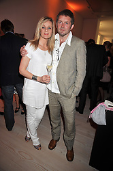 LINDA BARKER & CHRIS SHORT at the presentation of the Veuve Clicquot Business Woman Award 2009 hosted by Graham Boyes MD Moet Hennessy UK and presented by Sir Trevor Macdonald at The Saatchi Gallery, Duke of York's Square, Kings Road, London SW1 on 28th April 2009.