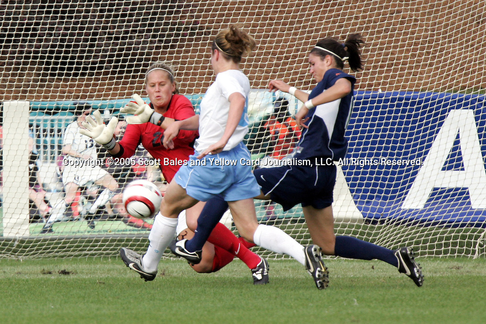 6 November 2005: Virginia goalkeeper Christina de Vries (red jersey) makes a first half save against North Carolina's Heather O'Reilly (closest to camera). The University of North Carolina defeated the University of Virginia 4-1 at SAS Stadium in Cary, North Carolina in theifinals of the 2005 ACC Women's Soccer Championship.