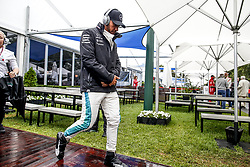 March 24, 2018 - Melbourne, Victoria, Australia - Motorsports: FIA Formula One World Championship 2018, Melbourne, Victoria : Motorsports: Formula 1 2018 Rolex  Australian Grand Prix,   #44 Lewis Hamilton (GBR, Mercedes AMG Petronas F1 Team),  Walking in the rain  (Credit Image: © Hoch Zwei via ZUMA Wire)