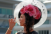 Ladies Day at the Oaks meeting at Epsom racecourse, Surrey, Britain, 03 June 2010. The Oaks Stakes is a Group 1 flat horse race for three-year-old thoroughbred fillies. It is run over a distance of 1 mile 4 furlongs and 10 yards (2,423 m) at Epsom Downs Racecourse always in early June. It is one of five British Classic Races. © under license to London News Pictures..