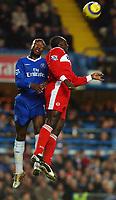 Photo. Daniel Hambury.<br /> Barclays Premiership.<br /> Chelsea v Middlesborough. 4/1/2005.<br /> Chelsea's William Gallas outjumps Middlesborough's Jimmy Floyd Hasselbaink