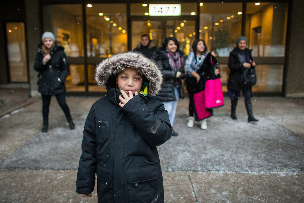Syrian refugee Nasimi Batal Al Hasan walks during snowfall in his winter jacket  their outside their apartment building in Mississauga, Ontario, Canada, Thursday January 21, 2016.   (Mark Blinch for the BBC)
