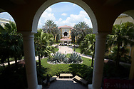A student stands under an arch of the Rosen College of Hospitality Management building at the University of Central Florida in Orlando, Fla., Tuesday, Aug. 25, 2015. (Phelan M. Ebenhack)