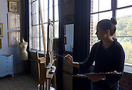 Cornwall, New York - An artist paints in the instruction area at the Andrew Lattimore Studio in Cornwall during the Orange County Arts Council Open Studio Tour on Oct. 14, 2012. The studio is located in a former textile mill.