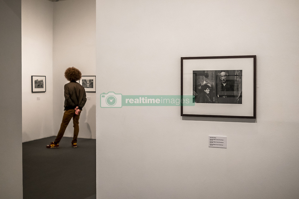 November 18, 2018 - Barcelona, Catalonia, Spain - A visitor seen observing the photographs of the Exit Photography Group in the exhibition halls at the La Virreina Image Center..For the first time in the Spanish context, Exit Photography Group exhibited on Barcelona Survival Programs. The exhibition was by Nicholas Battye, Chris Steele-Perkins and Paul Trevor. (Credit Image: © Paco Freire/SOPA Images via ZUMA Wire)