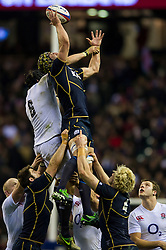Scotland Flanker (#7) Kelly Brown (Saracens, capt) wins a lineout against England Flanker (#6) Tom Wood (Northampton) during the second half of the match - Photo mandatory by-line: Rogan Thomson/JMP - Tel: Mobile: 07966 386802 02/02/2013 - SPORT - RUGBY UNION - Twickenham Stadium - London. England v Scotland - 2013 RBS Six Nations Championship. The winner of this fixture is awarded the Calcutta Cup.