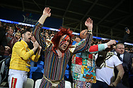 Newcastle Uttd fans wearing fancy dress celebrate their teams win at the end of the game.   EFL Skybet championship match, Cardiff city v Newcastle Utd at the Cardiff City Stadium in Cardiff, South Wales on Friday 28th April 2017.<br /> pic by Andrew Orchard, Andrew Orchard sports photography.