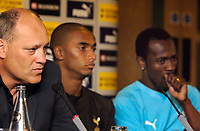 Photo: Daniel Hambury.<br /> Tottenham Hotspur PC. 31/07/2006.<br /> Spurs manager Martin Jol with two of his summer signings Benoit Assou-Ekotto (centre) and Didier Zukora.
