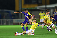 AFC Wimbledon midfielder Anthony Hartigan (8) is tackled by Brighton and Hove Albion midfielder Ed Turns (72) during the EFL Trophy Southern Group G match between AFC Wimbledon and Brighton and Hove Albion U21 at The People's Pension Stadium, Crawley, England on 22 September 2020.