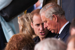 Lee Valley Athletic Centre, London, September 11th 2014. Charles the Prince of Wales and Duke of Cambridge Prince William chat betwen events at the Invictus Games track and field competition at Lee Valley Athletics Park in London.