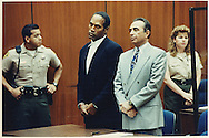 The OJ Simpson trial and media circus.<br /> OJ Simpson appearing at his arraignment for the murders of Ron Goldman and Nicole Brown Simpson. His lawyer Robert Shapiro is standing next to him.<br /> He plead not-guilty.