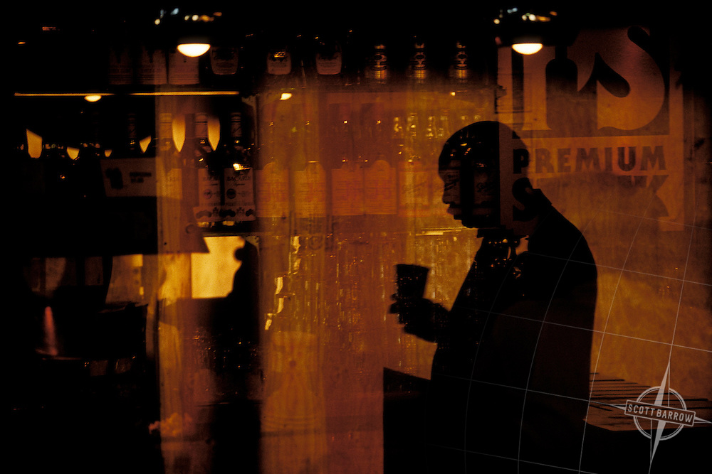 Reflection of man in a bar window