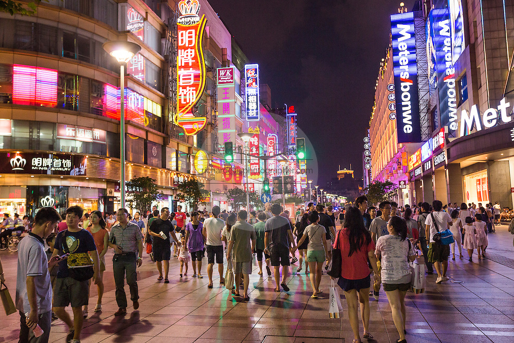People shop on Nanjing East Road in Shanghai, China.