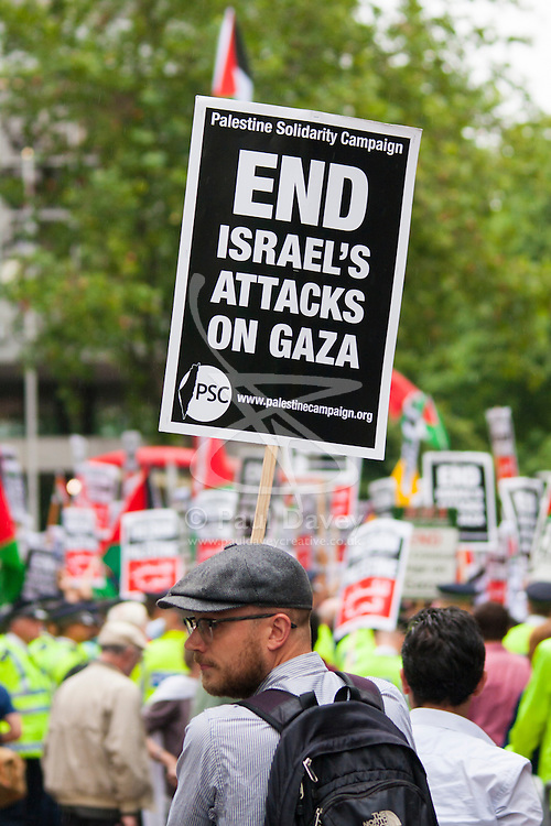 """London, July 5th 2014. Hundreds protest near the Israeli embassy in London against the ongoing occupation of Palestine and the west's support of """"Israel's collective punishment of Palestinians""""."""