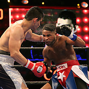 WINTER PARK, FL - AUGUST 02: Yudel Jhonson of Havana, Cuba (R) fights against Jorge Cota of Sinaloa, Mexico during the Premier Boxing Champions on Bounce TV boxing match at Full Sail University - Ebbs Auditorium on August 2, 2015 in Winter Park, Florida. Cota won the bout by unanimous decision. (Photo by Alex Menendez/Getty Images) *** Local Caption *** Yudel Jhonson; Jorge Cota